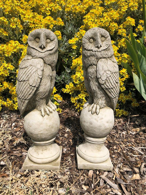 A pair of stone owl finials.