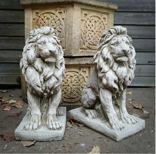 A regal pair of stone lions with an antique style.