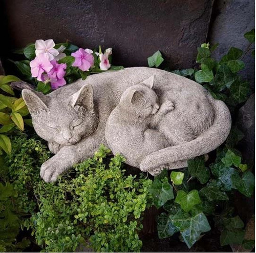 A stone cat statue with her kitten, a garden ornament.