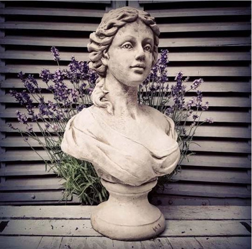 A classical stone bust of a French Maid. A garden ornament.