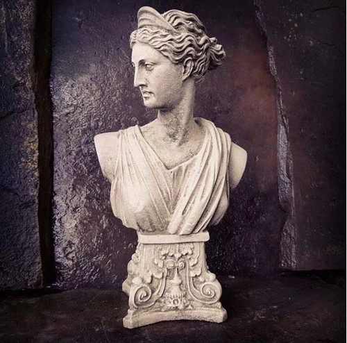 A classical stone bust of Athena. A garden ornament.