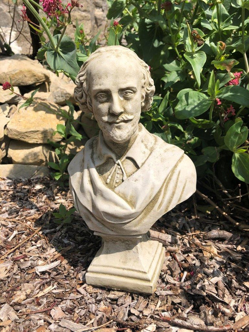 A classical stone bust of Shakespeare. A garden ornament.