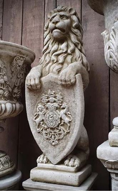 A large, detailed stone lion statue. A home and garden ornament.