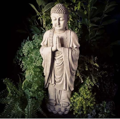 A large, detailed stone buddha statue. A garden ornament.