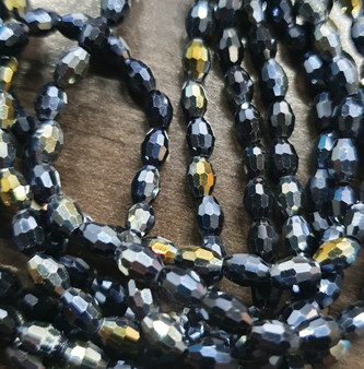 6x4mm  - Black AB - Strand (approx 72 beads)  - Faceted Oval Fire Electroplated Glass Beads