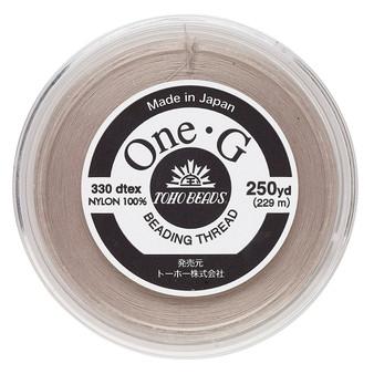 Thread, TOHO BEADS®, One-G™, nylon. 1 x Spool Size O - 250yds Beige