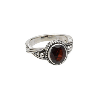 Ring, garnet (natural) and antiqued sterling silver, 9x7mm faceted oval, size US6. Sold individually.