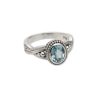 Ring, sky blue topaz (irradiated) and antiqued sterling silver, 9x7mm faceted oval, size 8. Sold individually.