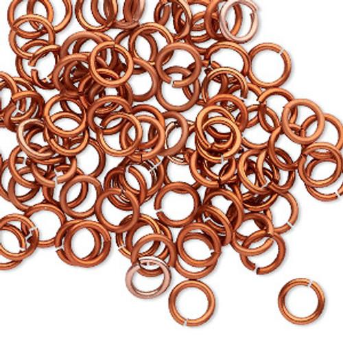 Jump ring, anodized tempered aluminum, Orange Copper, 6mm round, 4.2mm inside diameter, 18 gauge. Sold per pkg of 100.