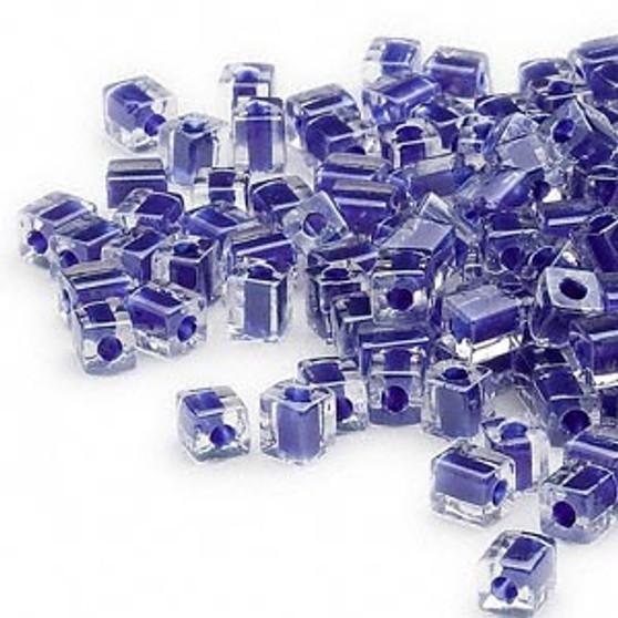 SB4-239 - Miyuki - 4mm - Clear Colour Lined Cobalt - 25gms - 4mm Square Glass Bead