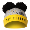 """A Grey based beanie, with black pom poms and a yellow strip running across the forehead to the back. Displaying """"YAY TIGERS"""" along the front yellow strip with the combination of yellow and black dots on the grey part."""