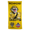 "bright yellow towel with Mark Knight cartoon tiger on the front. Text saying ""Richmond Premiers 19"" Club and premiers logo."