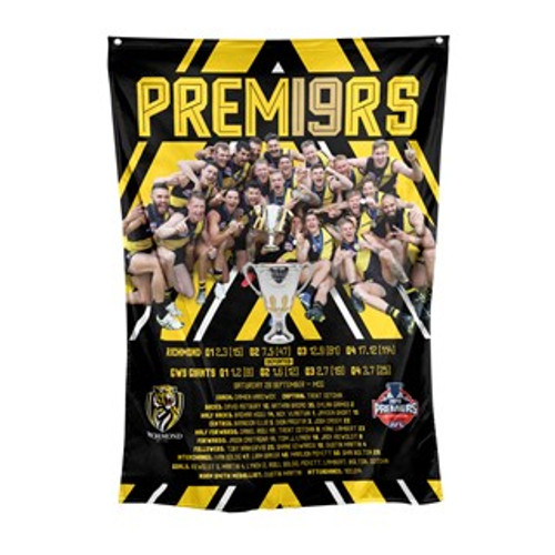 Black flag with yellow detailing. Image of players celebrating with the premiership cup.