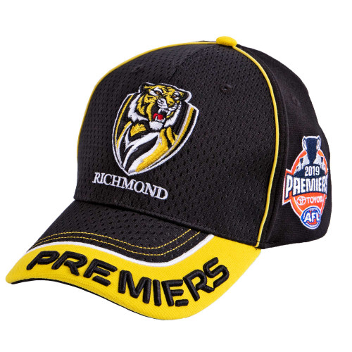 Black 2019 AFL Premiers cap with yellow lining around edge. Features RFC and 2019 Premiers logos.