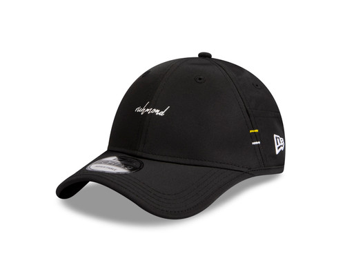 Black  Richmond AFLW sports lifestyle cap with Richmond in white script writing. Cap is adjustable on back.