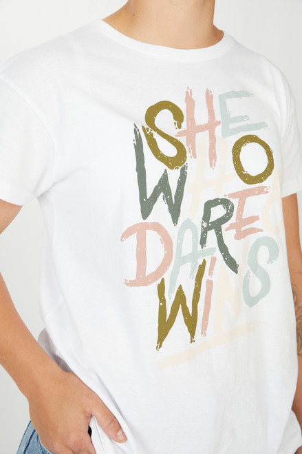 "AFLW short sleeve t-shirt, multi-coloured print on the front which says ""she who dares wins"" and a black print on the back with the AFLW logo. Round neckline, a comfortable fit, Be sustainable; this tee is made from 100% sustainably sourced cotton."