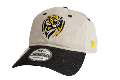 A New Era beige  cap with a slightly curved black peak. It has the Richmond club emblem on the front in the middle. The cap has an adjustable back.