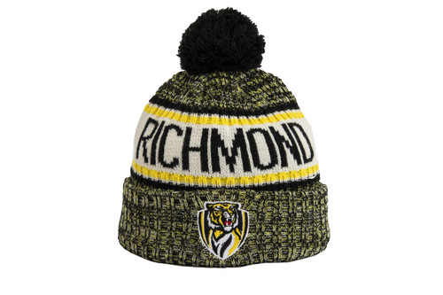 A New Era mixed yellow and black stitched beanie with the Richmond club emblem on the front middle of the flipped up strip that sits on the forehead.  This beanie has a black pom pom on the top, as well as Richmond in block letters in a strip on the middle on the beanie.