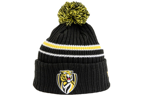 2020 New Era Team Knit Beanie, displaying the club logo emblem in the centre on the forehead with a mixed yellow and black pom pom on top of the beanie. The beanie is a black base with one horizontal yellow stripe running across it.