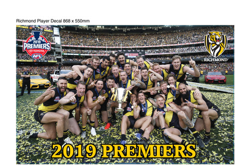 """Picture of the players all celebrating on the MCG oval holding the cup. Words """"2019 PREMIERS"""" on the bottom and the club and premiership logo on the top corners."""