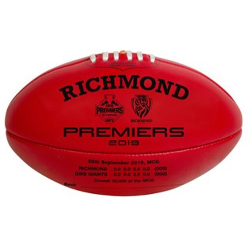 "A red football with black writing on it. This writing has ""2019 Richmond Premiers"" with some other statistics."