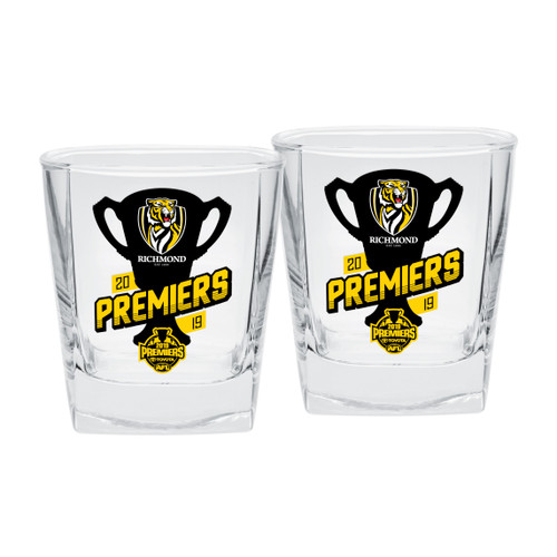 "Clear square glasses with rounded edges. Black silhouette of the premiership cup and yellow writing saying ""premiers"" on 1 side of both glasses."
