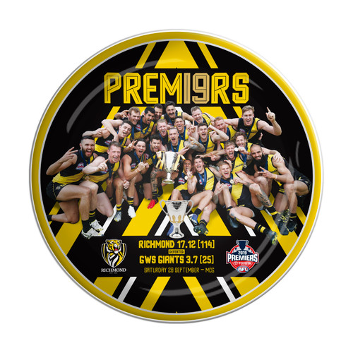 Black plate with yellow detailing. Image of the players celebrating holding the premiership cup