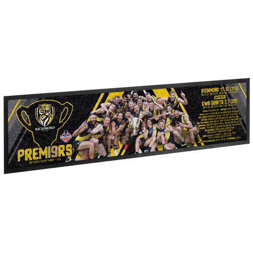 black bar runner with picture of the players on the front. details about the game in yellow text on the side.