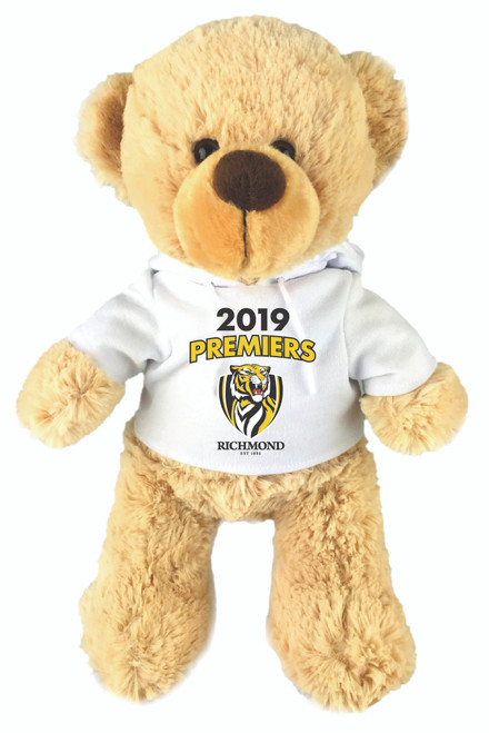 """Super soft plush teddy bear wearing a all white hoodie with words """"2019 Premiers"""" with the team logo."""