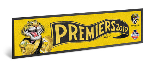 "Bright yellow background with Mark Knight cartoon tiger design on the front with a pennant with text ""Premiers"""