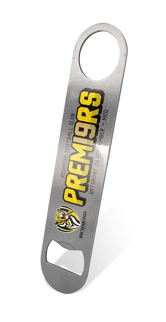 "A flat long grey piece of stainless steel with round ends. ""Premiers"" in yellow writing and team logo."