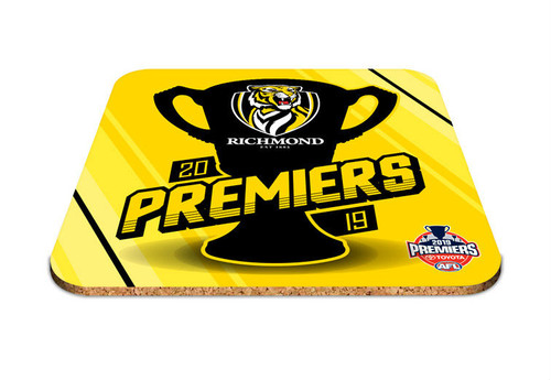 "Bright yellow coaster with black premiership silhouette with the words ""premiers"" in yellow across the cup"