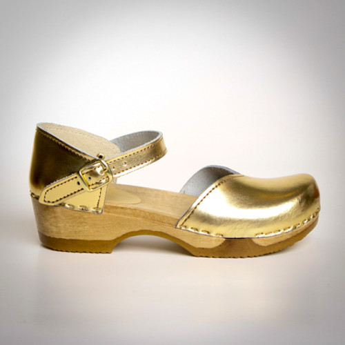 Pictured in Gold Metallic Leather with Brown Base.