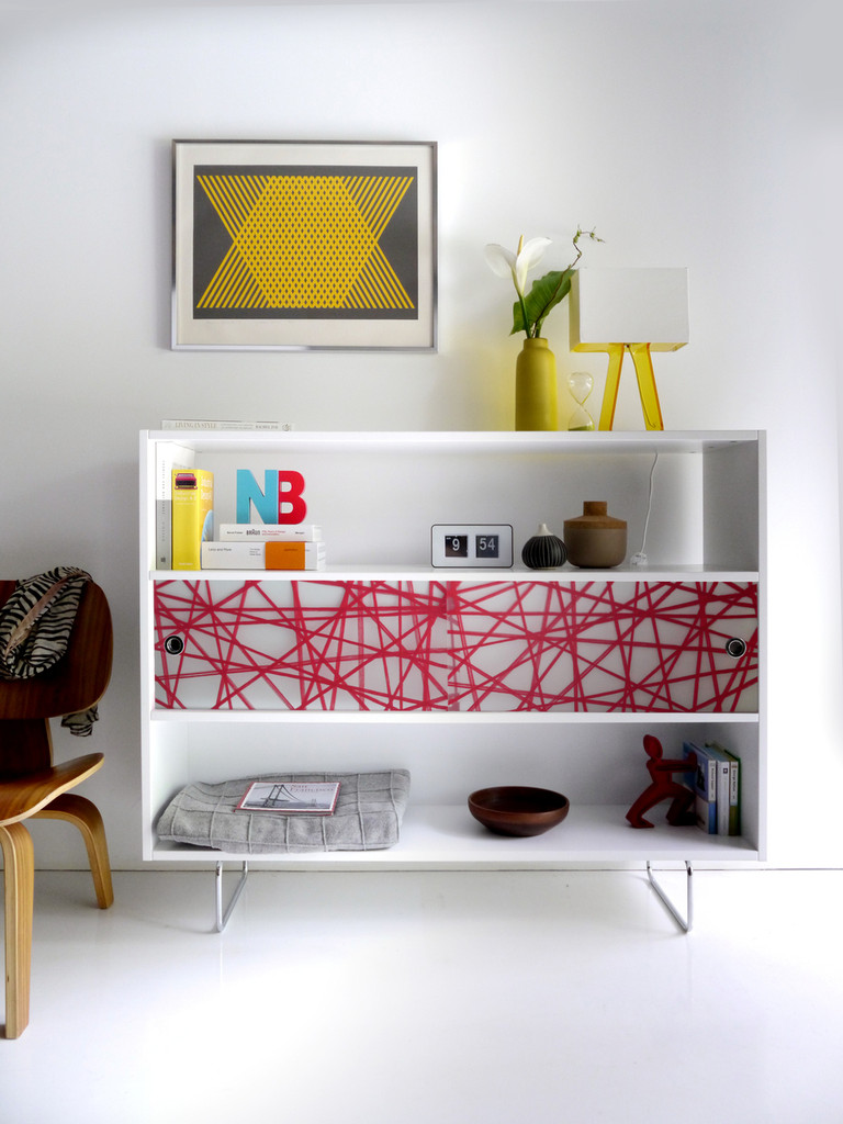 Alto Shelving shown with Red Strand panels.