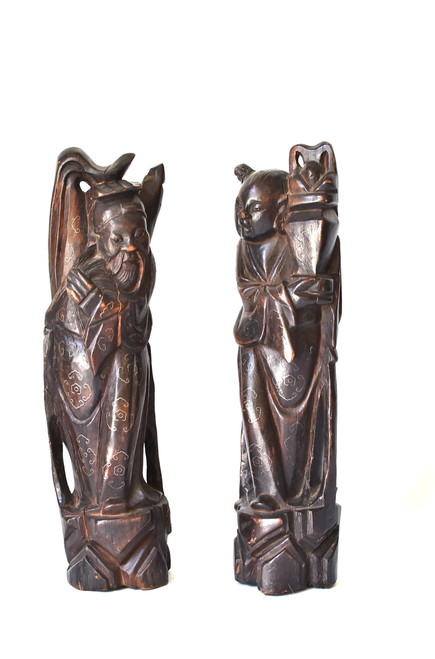 pair of figures, with silver inlay
