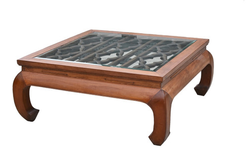large coffee table with antique screen