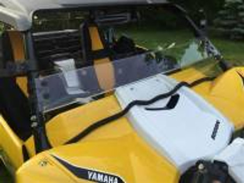 "Yamaha YXZ Hard Coated Polycarbonate Half Shield/ Wind Deflector  Fits: 2016 Yamaha YXZ1000R If you need a full windshield see P/N: 13190  Made from 3/16"" Thick Hard Coated Polycarbonate. Will not easily crack like cheaper acrylic windshields. Attaches with Rubber Fast Straps. Can be removed in seconds. Contoured to hood with full length rubber seal Made In Cleveland Ohio by EMP®-Logo in part. This is CNC routered from 3/16"" Thick Hard Coated Polycarbonate making it very durable. A half shield is a great alternative to a full windshield. It allows for airflow keeping you cool and is low enough you can see over it when it gets dirty. It can easily be removed without any tools. Simply, unhook the rubber mounting straps. The bottom edge trim seals and protects your hood.  We reserve the right to make modifications/improvements to our products at any time. Vehicles may have changes throughout the year. Therefore, pictures are a representation of the product you will be getting but may vary due to product revisions."