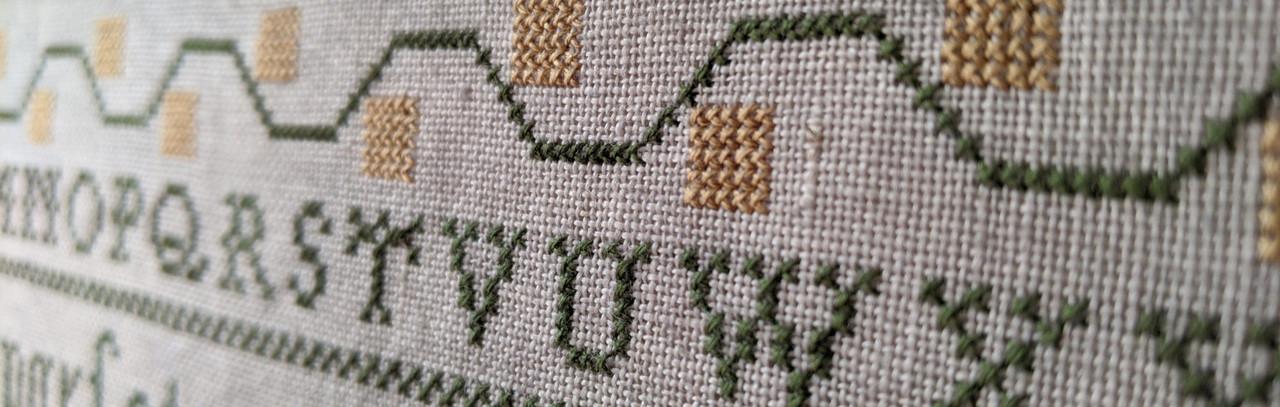 Close up of Emily Harben Reproduction Sampler
