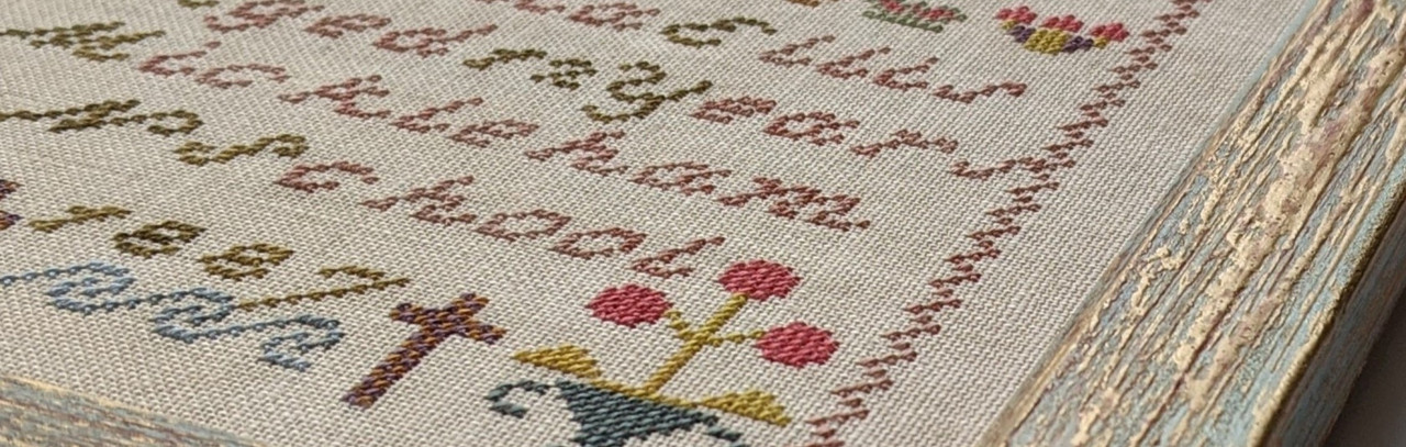 Close up of Emily Harben Reproduction Sampler