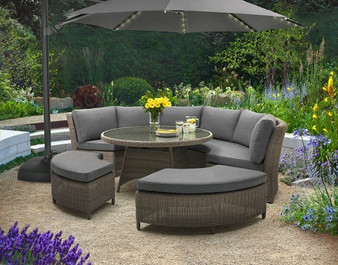 Palma round Casual dining Set in Rattan Weave pictured with 3m overhanging parasol