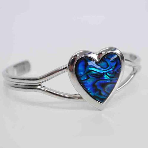 Heart shaped silvertone bracelet inlaid with paua.