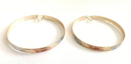 Tri-Tone Diamond Cut Bangle Earrings  Large diamond cut tri-tone bangle hoop earrings. Made in India.
