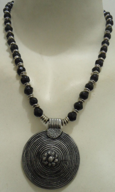 "Silver/Black Ribbed Medallion Necklace  12-14"" length; black and silver beading. Made in India."