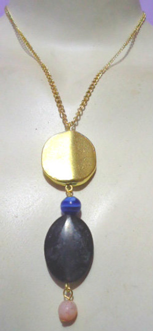 "Black/Gold Pendant Necklace  12-14"" black pendant. Made in India."
