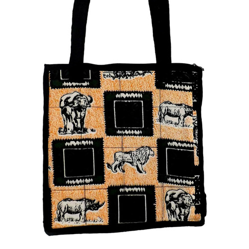 """Safari Animal Print Shopping Tote Bag  100% cotton tote is 13"""" in length and width; 11"""" shoulder drop.  Padded inside, and one large interior pocket.  Zippered closure.  Made in Kenya."""