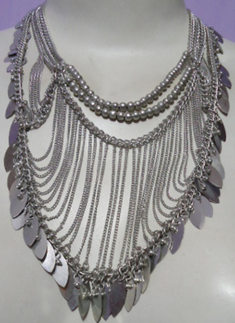 """Silver Draped Chain Necklace  Silver toned 14"""" draped chain necklace with silver leafs; designed with 4 chains; made of iron. Made in India."""