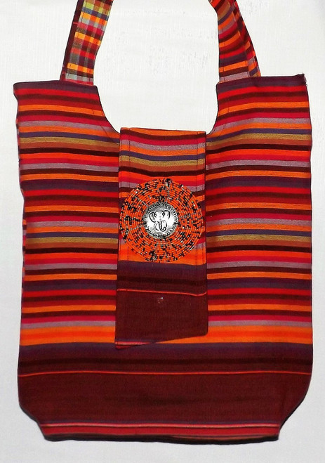 """Kikoy Maasai Tote Bag  Stylish Maasai tote bag can be used for the beach or daily practical use; added beauty of the popular maasai beads and engraved metal pendant of one of Africa's popular safari animals.  15x13x13. Strap drop is 9"""", lined bag; interior pocket and zips close at the top.   Made in Kenya."""