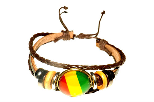 Brown Leather Rasta Bracelet  One size fits most; adjustable, center is acrylic. Made in China.