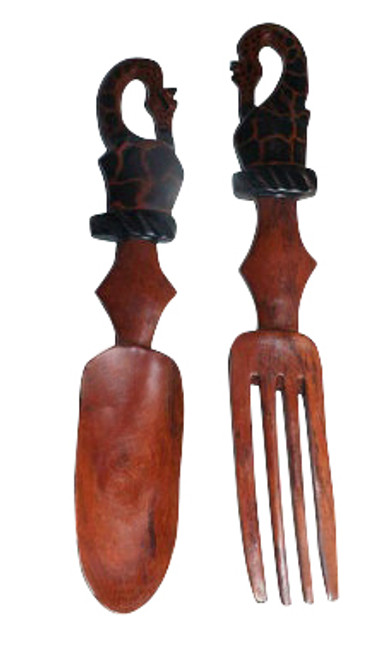 "12"" African Safari Animal Wooden Salad Set  Various safari animal prints, handmade in real wood...treat with care.  Prints are on one side only.   Wood care  Always hand wash wood utensils with soap and warm water. The harsh detergent and heat in the dishwasher will wreck the wood in just a few cycles. Dry wooden spoons with a towel instead of letting them air dry. Residual moisture from washing will get absorbed into the wood, causing the wood to swell and crack over time. Once a month or so, rub in a little mineral oil with a soft cloth and let it sit for a few hours. Mineral oil is a food safe product that won't go rancid the way olive oil or other cooking oils would. It gets absorbed quickly, leaving wooden handles smooth but not greasy."