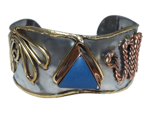 """Diamond Blue Mixed Metals Cuff Bracelet  Faux diamond shape stone in the center copper and brass accents 7"""" from end to end 1"""" gap 2"""" width"""